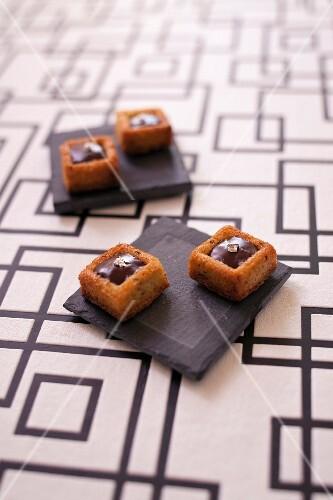 Mini hazelnut Savarins with almond-flavored ganache