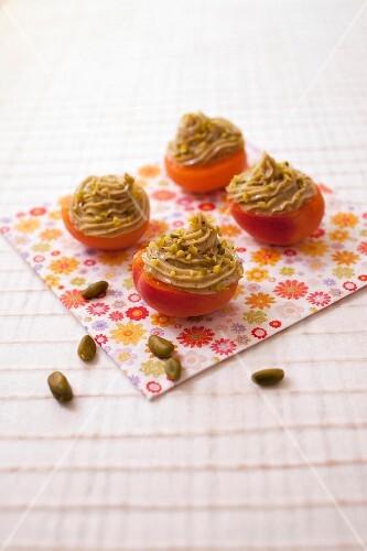 Apricots garnished with pistachio mascarpone