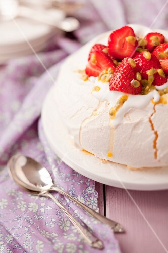 Pavlova with strawberries and passion fruit