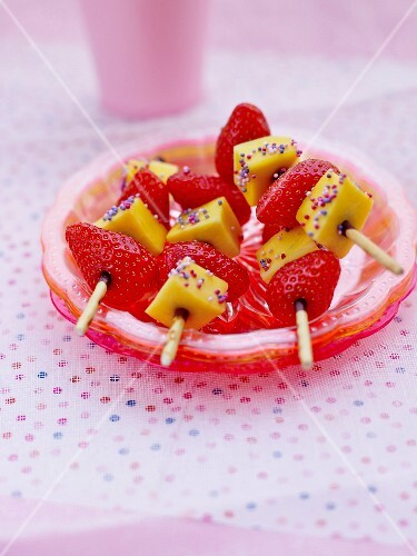 Strawberry and mango skewers with colourful sugar sprinkles