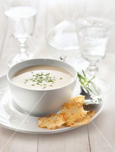 Creamed parsnip soup with emmental crisps
