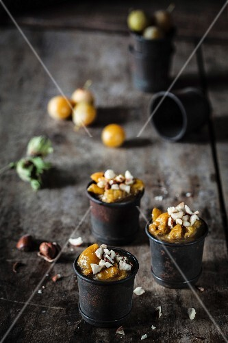Stewed plums with crushed hazelnuts