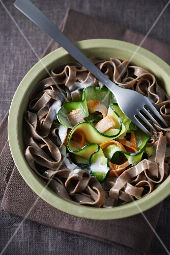 Buckwheat tagliatelles with vegetables,bacon and cream