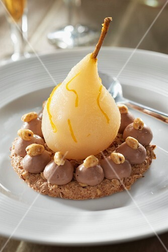 Pear-chocolate delice on a hazelnut Dacquoise