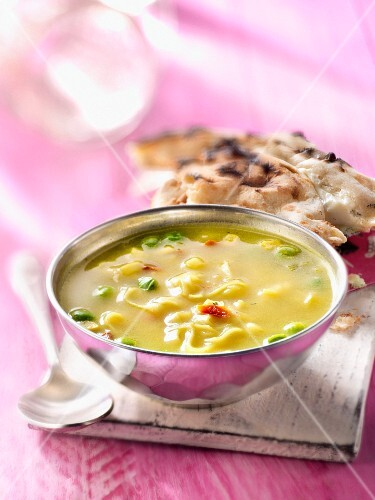 Indian soup with cheese nan