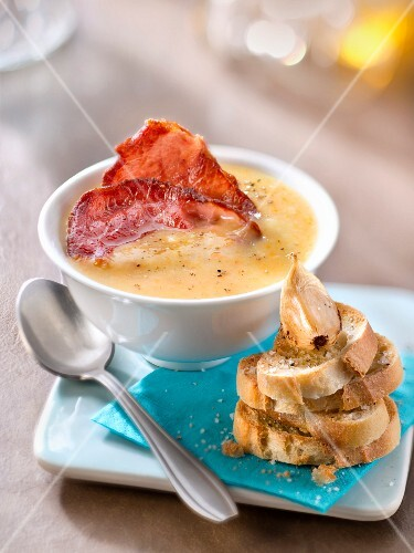 Creamed vegetable soup with crisp bacon,garlic toasts