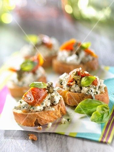 Philadelphia cheese,confit tomato and herb bruschettas