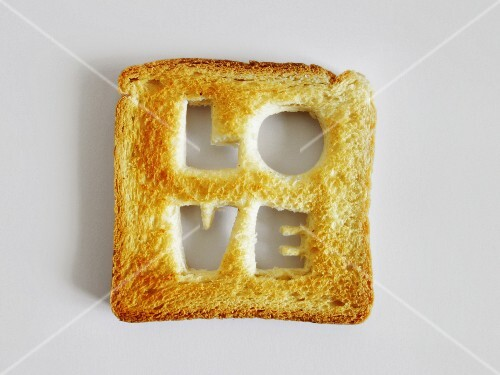 """The word """"Love"""" cut out of a slice of toast"""