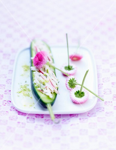 Cucumber with thinly sliced radishes and daisies