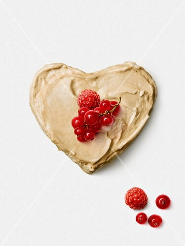 Peanut butter heart topped with summer fruit