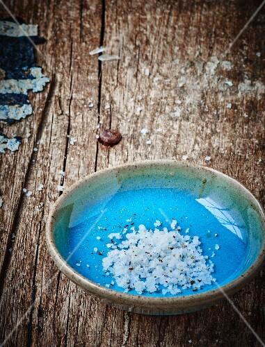 Bowl of coarse salt and ground black pepper
