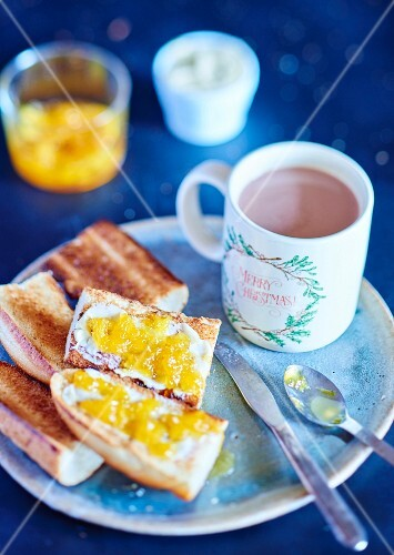 Breakfast with marmelade on toast and a cup of hot chocolate