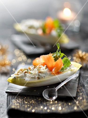 Crisp chicory leaves garnished with ricotta,dill and smoked salmon