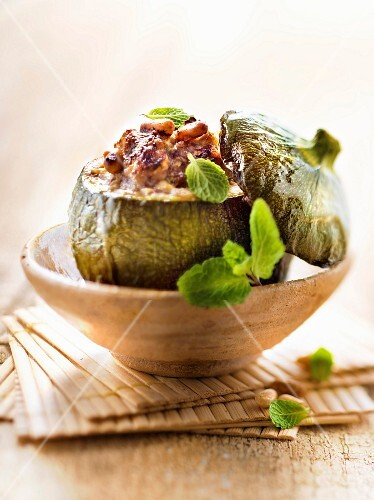 Round zucchini stuffed with lamb,pine nuts and mint