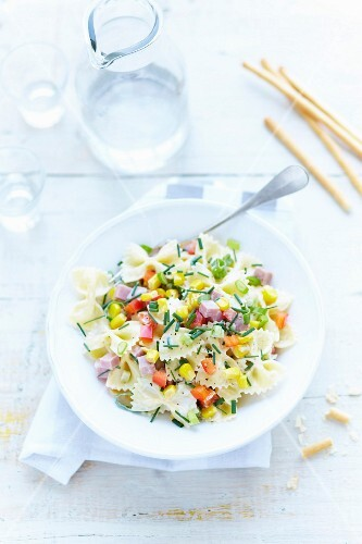 Pasta salad with farfalle, diced ham and sweetcorn