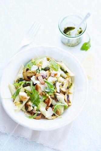 Pasta salad with penna, pesto, chicken and mushrooms