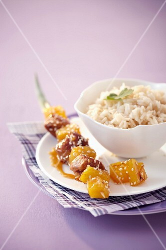Chicken kebab with pineapple and sesame, rice