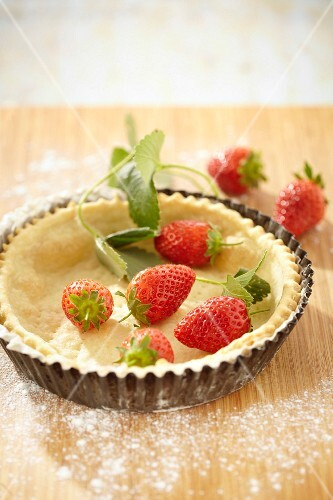 A strawberry tartlet being made
