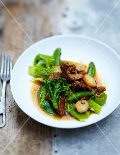 Spicy pork with green cabbage, broccoli and sugar peas