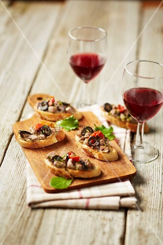 Homemade wild boar paté with olives on sliced bread
