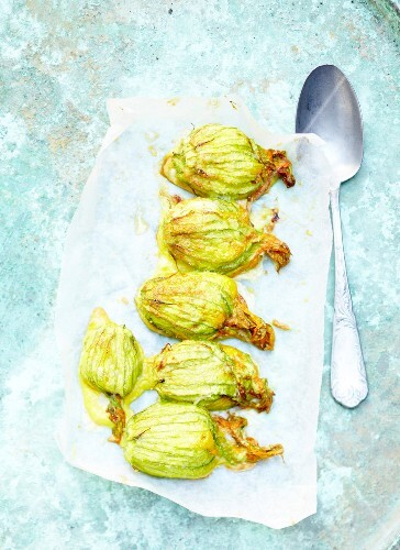 Grilled zucchini flowers stuffed with parmesan