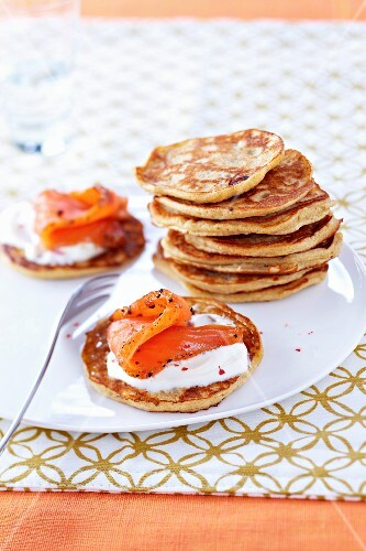 Blinis with thick cream and smoked salmon