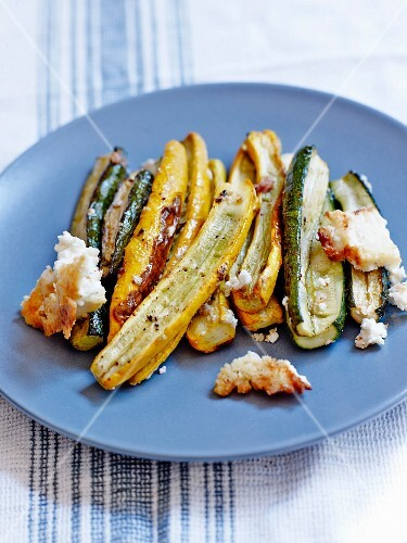 Yellow and green zucchinis roasted with feta