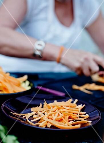 Person peeling carrots