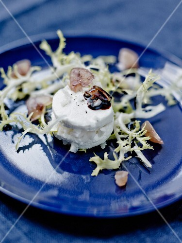 Goat's cheese garnished with black radish,candied chestnut crumbs