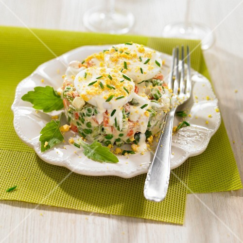 Diced vegetables in mayonnaise topped with mimosa eggs