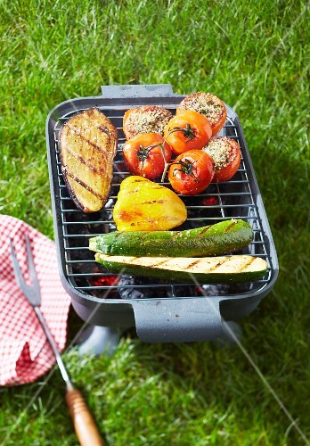 Grilling vegetables on a barbecue outdoors