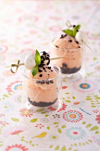 Tomato-olive ice cream garnished with mini mozzarella balls