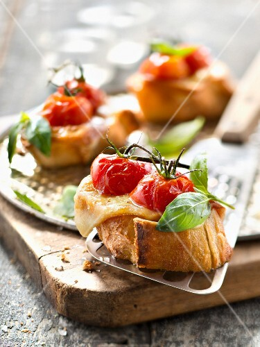 Roasted cherry tomato,smoked scamorza and basil crostinis
