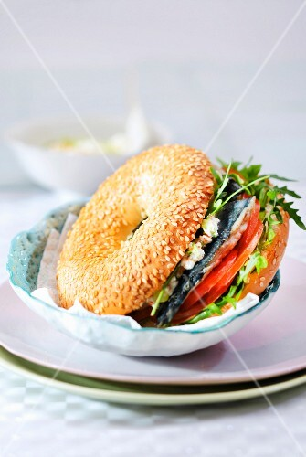 Lisette, tomato, rocket lettuce and cucumber Fromage blanc bagel sandwich