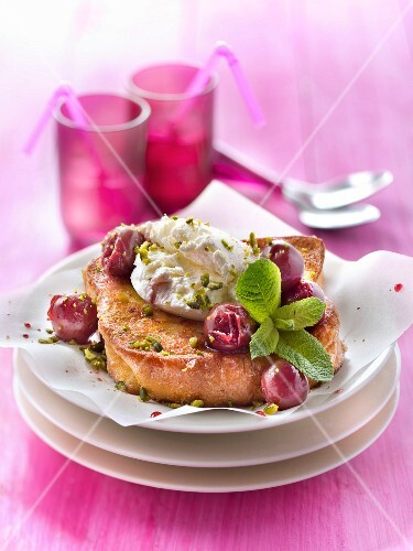 Brioche French toast with griotte sour cherries and pistachios