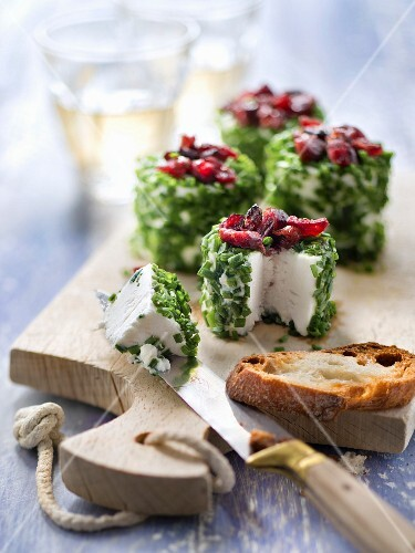 Small goat's cheese coated in chopped chives and topped with cranberries