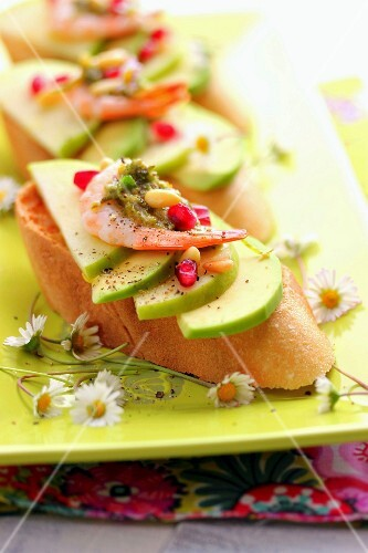 Avocado,Granny Smith apple,shrimp,pomegranate and daisy pesto bruschetta