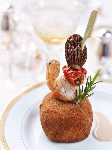 Risotto in parmesan crust with grilled langoustine and morel