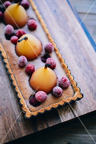 Poached pear,almond cream and raspberry gluten-free tart