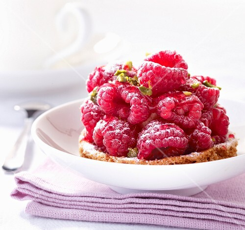 Raspberry and crushed pistachio tartlet