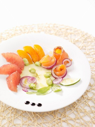 Plate of smoked salmon,grapefruit,peach and green apple