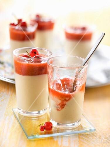 Vanilla cream dessert with redcurrants and raspberry coulis