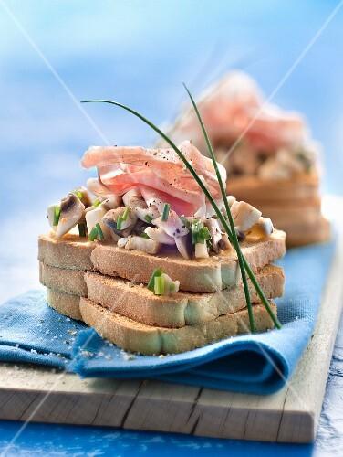 Button mushroom,chive and raw ham crisp open sandwiches