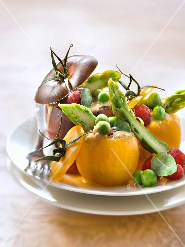 Tomatoes stuffed with young vegetables,mustard dressing