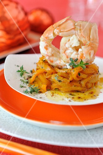Roasted langoustine tails with yellow peppers and orange
