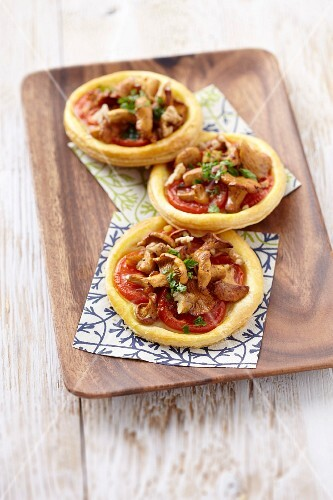 Chanterelle and tomato tartlets