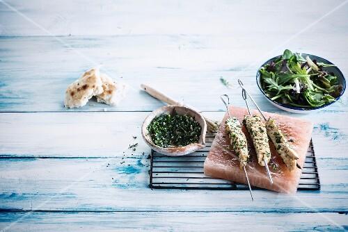 Marinated chicken brochettes with fresh herbs