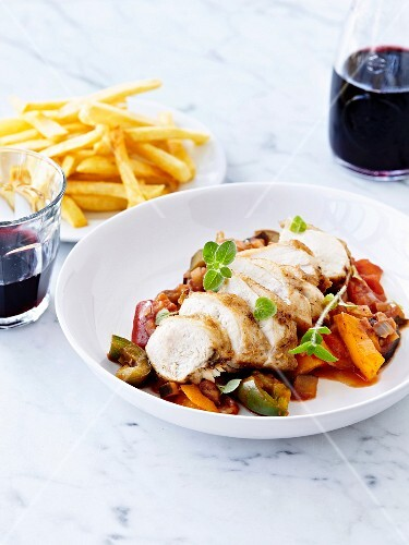 Chicken breast supreme,ratatouille and French fries,red wine