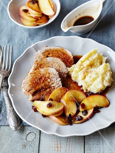 Sliced of roast veal with gravy,raisins and apples,mashed potatoes