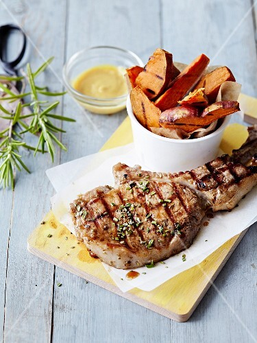 Grilled lamb chop,slices of roasted sweet potatoes